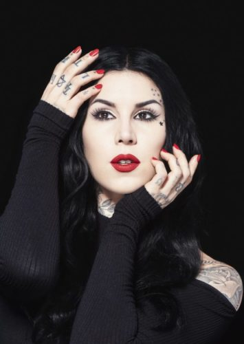 Kat Von D picture. Black hair. Red lips and nails. Gothic style